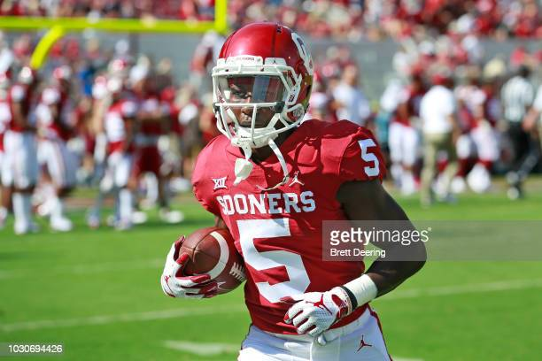 Wide receiver Marquise Brown of the Oklahoma Sooners warms up before the game against the Florida Atlantic Owls at Gaylord Family Oklahoma Memorial...