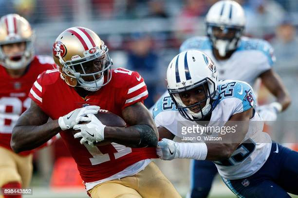 Wide receiver Marquise Goodwin of the San Francisco 49ers breaks a tackle from cornerback Adoree' Jackson of the Tennessee Titans during the fourth...