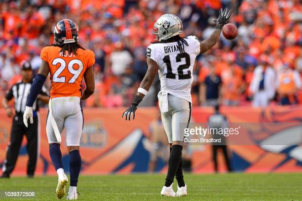 Wide receiver Martavis Bryant of the Oakland Raiders celebrates by dropping the ball after a catch was initially ruled a first down play in the...