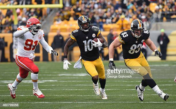 Wide receiver Martavis Bryant of the Pittsburgh Steelers runs behind the blocking of tight end Heath Miller as he is pursued by linebacker Tamba Hali...