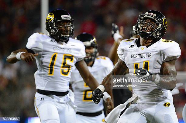 Wide receiver Martez Carter of the Grambling State Tigers celebrates alongside quarterback Trevon Cherry after scoring a touchdown against the...