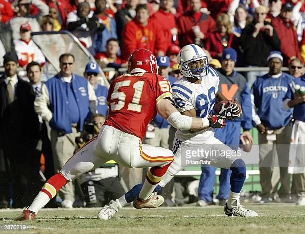 Wide receiver Marvin Harrison of the Indianapolis Colts makes a move on Scott Fujita of the Kansas City Chiefs in the AFC Divisional Playoffs on...