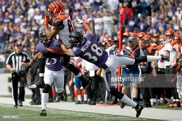 Wide receiver Marvin Jones of the Cincinnati Bengals catches the ball while cornerback Rashaan Melvin of the Baltimore Ravens defends in the first...