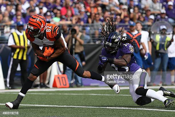 Wide receiver Marvin Jones of the Cincinnati Bengals scores a second quarter touchdown past free safety Kendrick Lewis of the Baltimore Ravens during...