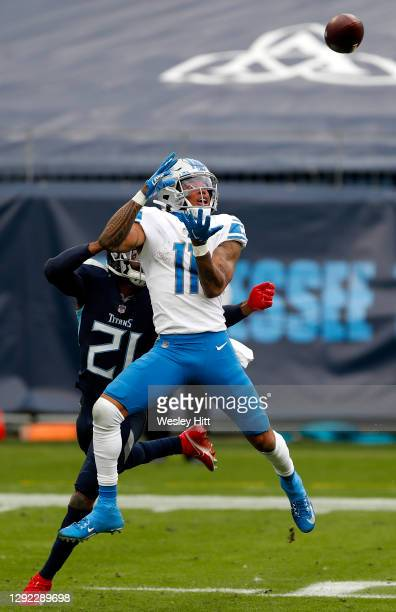 Wide receiver Marvin Jones of the Detroit Lions leaps for a pass over cornerback Malcolm Butler of the Tennessee Titans during the second quarter of...