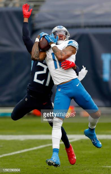 Wide receiver Marvin Jones of the Detroit Lions makes a reception over cornerback Malcolm Butler of the Tennessee Titans during the second quarter of...