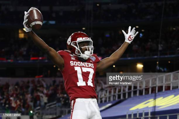 Wide receiver Marvin Mims of the Oklahoma Sooners celebrates a 27-yard touchdown catch against the Florida Gators during the first quarter at AT&T...