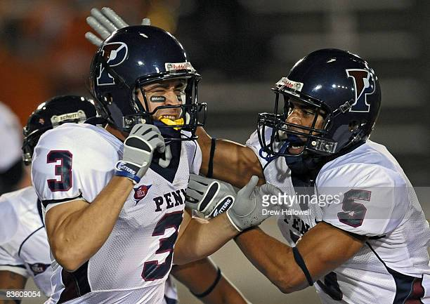 Wide receiver Matt Appenfelder of the Pennsylvania Quakers celebrates his touchdown with teammate wide receiver Marcus Lawrence during the game...