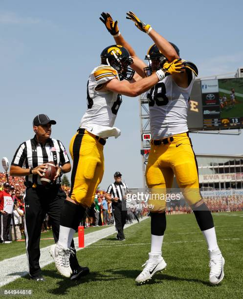 Wide receiver Matt VandeBerg of the Iowa Hawkeyes celebrates with teammates tight end TJ Hockenson of the Iowa Hawkeyes after scoring a touchdown in...