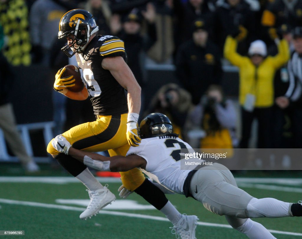 Wide receiver Matt VandeBerg #89 of the Iowa Hawkeyes rushes up field during the second quarter in front of cornerback Da'Wan Hunte #2 of the Purdue Boilermakers on November 18, 2017 at Kinnick Stadium in Iowa City, Iowa.