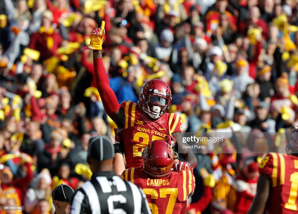 Wide receiver Matthew Eaton #23 of the Iowa State Cyclones is lifted up by teammate offensive lineman Jake Campos #67 of the Iowa State Cyclones after he scored a touchdown in the first half of play against the TCU Horned Frogs at Jack Trice Stadium on October 28, 2017 in Ames, Iowa.