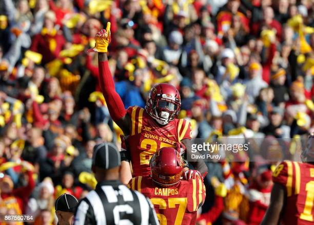 Wide receiver Matthew Eaton of the Iowa State Cyclones is lifted up by teammate offensive lineman Jake Campos of the Iowa State Cyclones after he...