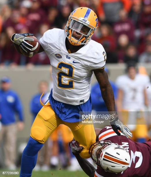 Wide receiver Maurice Ffrench of the Pittsburgh Panthers is hit following his reception by cornerback Greg Stroman of the Virginia Tech Hokies in the...