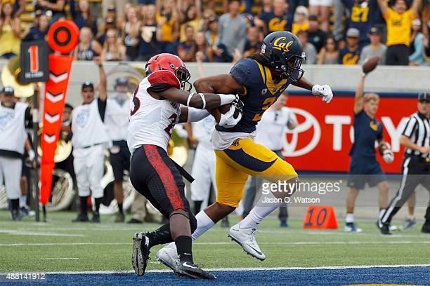 Wide receiver Maurice Harris of the California Golden Bears scores a touchdown past defensive back Damontae Kazee of the San Diego State Aztecs...