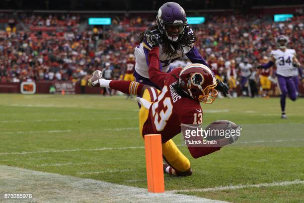 Wide receiver Maurice Harris of the Washington Redskins catches a touchdown past cornerback Trae Waynes of the Minnesota Vikings during the first...