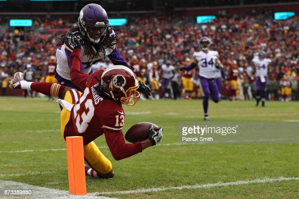 Wide receiver Maurice Harris of the Washington Redskins catches a touchdown pass in front of cornerback Trae Waynes of the Minnesota Vikings during...