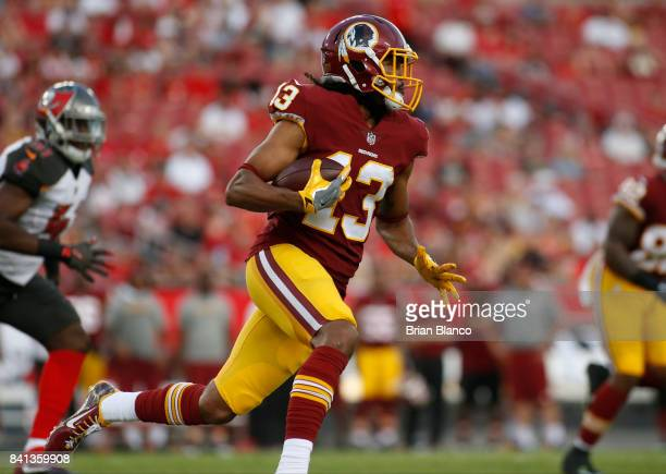 Wide receiver Maurice Harris of the Washington Redskins runs for several yards during the first quarter of an NFL preseason football game against the...