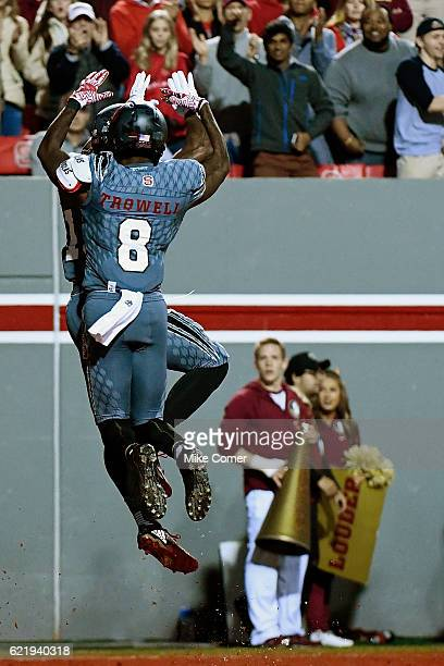 Wide receiver Maurice Trowell chest bumps wide receiver Bra'Lon Cherry of the North Carolina State Wolfpack after Cherry scored a touchdown against...