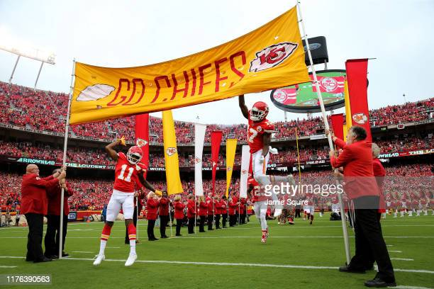 Wide receiver Mecole Hardman and teammate wide receiver Demarcus Robinson of the Kansas City Chiefs take the field for their game against the...