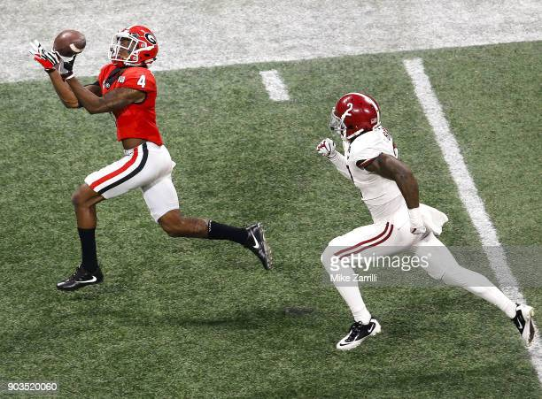 Wide receiver Mecole Hardman catches a pass for a touchdown behind safety Tony Brown of the Alabama Crimson Tide during the College Football Playoff...