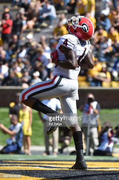 Wide receiver Mecole Hardman of the Georgia Bulldogs celebrates a touchdown against the Missouri Tigers in the fourth quarter at Memorial Stadium on...