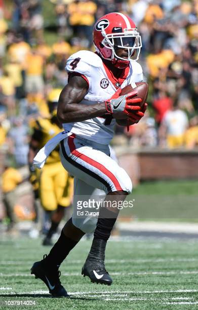 Wide receiver Mecole Hardman of the Georgia Bulldogs runs for a touchdown pass against the Missouri Tigers in the fourth quarter at Memorial Stadium...