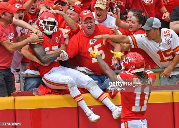Wide receiver Mecole Hardman of the Kansas City Chiefs leaps into the stands after scoring a touchdown against the Baltimore Ravens during the first...