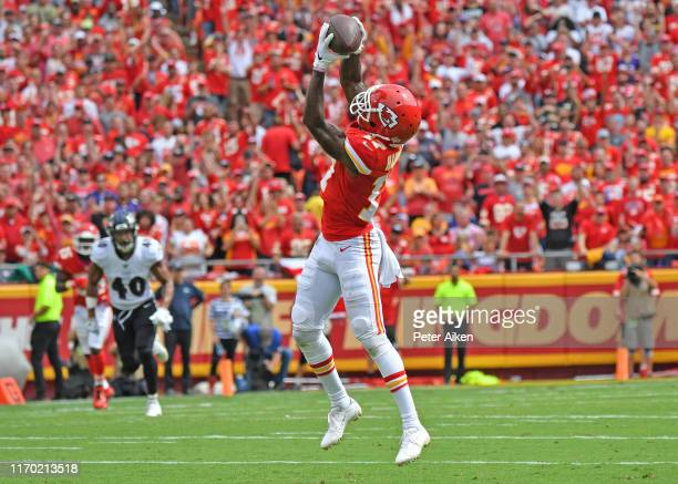 Wide receiver Mecole Hardman of the Kansas City Chiefs reaches up to catch a touchdown pass against the Baltimore Ravens during the first half at...