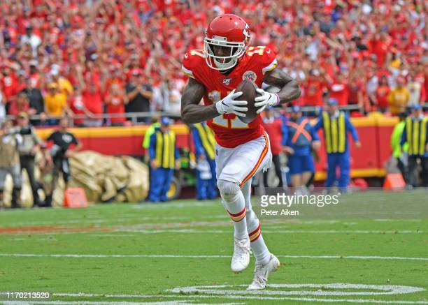 Wide receiver Mecole Hardman of the Kansas City Chiefs rushes for a touchdown pass against the Baltimore Ravens during the first half at Arrowhead...