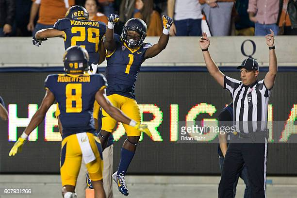 Wide receiver Melquise Stovall of the California Golden Bears celebrate a 29-yard touchdown with running back Khalfani Muhammad and wide receiver...