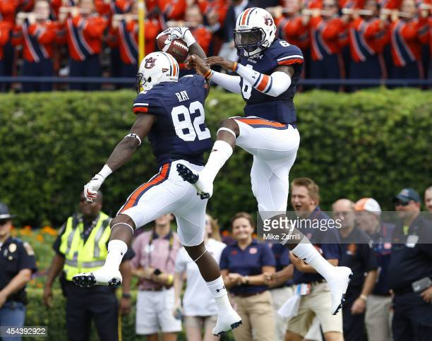 Wide receiver Melvin Ray and quarterback Jeremy Johnson of the Auburn Tigers celebrate Ray's touchdown during the game against the Arkansas...