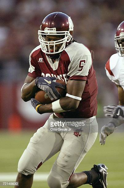 Wide receiver Michael Bumpus of the Washington State Cougars runs with the ball during the game against the USC Trojans on September 30 2006 at...