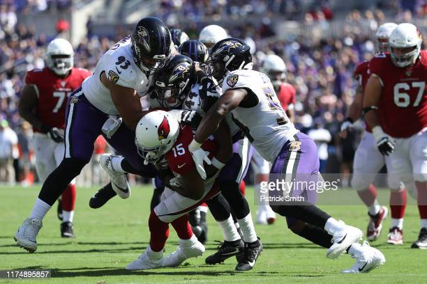 Wide receiver Michael Crabtree of the Arizona Cardinals is tackled by multiple Baltimore Ravens defenders during the second half at MT Bank Stadium...