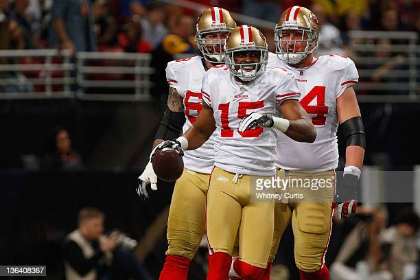 Wide receiver Michael Crabtree of the San Francisco 49ers celbrates his touchdown against the St Louis Rams with teammates guard Adam Snyder and...