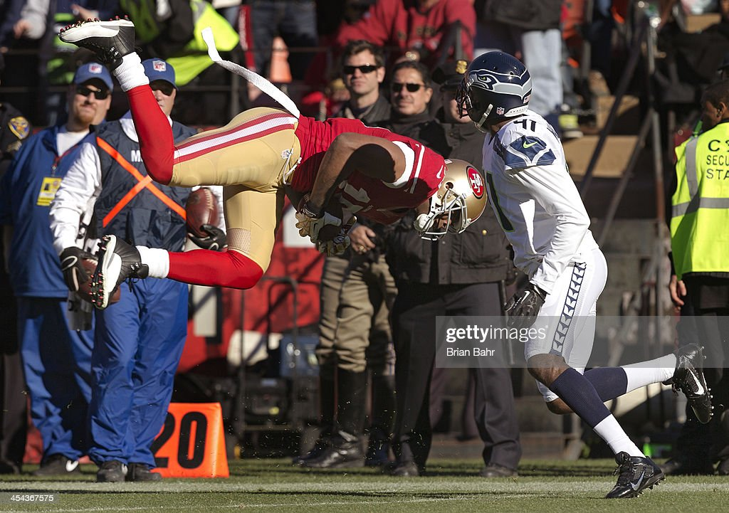 Wide receiver Michael Crabtree #15 of the San Francisco 49ers snags a pass and heads for the ground in front of cornerback Byron Maxwell #41 of the Seattle Seahawks in the second quarter on December 8, 2013 at Candlestick Park in San Francisco, California. The 49ers won 19-17.
