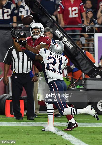 Wide receiver Michael Floyd of the Arizona Cardinals attempts to make a catch while being defended by Malcolm Butler of the New England Patriots at...