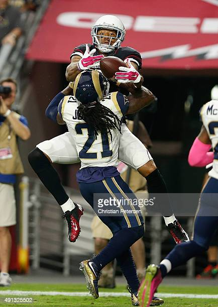 Wide receiver Michael Floyd of the Arizona Cardinals can't haul in a pass while being defended by cornerback Janoris Jenkins of the St Louis Rams...