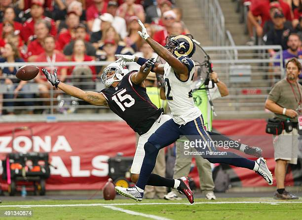 Wide receiver Michael Floyd of the Arizona Cardinals can't haul in a pass while being defended by cornerback Trumaine Johnson of the St Louis Rams...