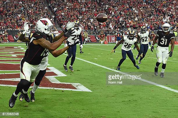 Wide receiver Michael Floyd of the Arizona Cardinals catches a 5 yard touchdown reception in front of cornerback Troy Hill of the Los Angeles Rams...