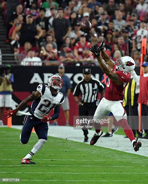 Wide receiver Michael Floyd of the Arizona Cardinals catches a pass for a 39yard gain against cornerback Malcolm Butler of the New England Patriots...