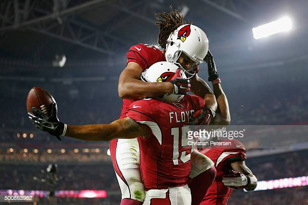 Wide receiver Michael Floyd of the Arizona Cardinals celebrates with wide receiver Larry Fitzgerald after scoring a 42 yard touchdown during the...