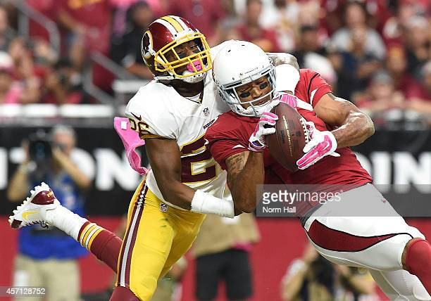 Wide receiver Michael Floyd of the Arizona Cardinals hauls in a firstquarter touchdown pass against corner back Bashaud Breeland of the Washington...