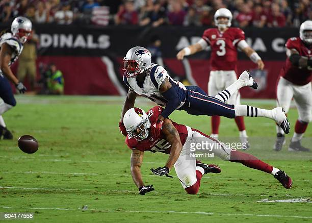 Wide receiver Michael Floyd of the Arizona Cardinals is unable to make a catch against cornerback Malcolm Butler of the New England Patriots at...