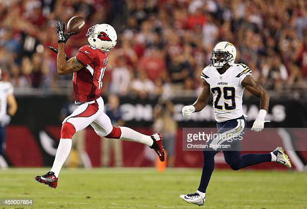 Wide receiver Michael Floyd of the Arizona Cardinals makes a 63 yard reception past cornerback Shareece Wright of the San Diego Chargers in the first...