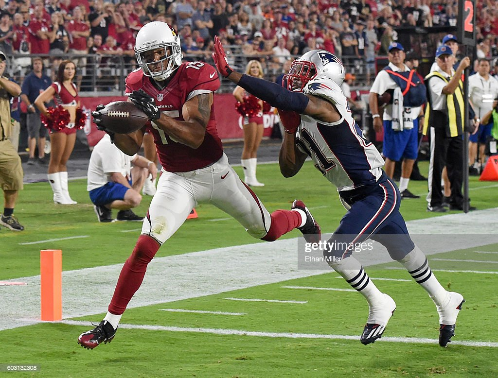 Wide receiver Michael Floyd #15 of the Arizona Cardinals misses a pass in the end zone under pressure from cornerback Malcolm Butler #21 of the New England Patriots during the NFL game at University of Phoenix Stadium on September 11, 2016 in Glendale, Arizona. New England won 23-21.