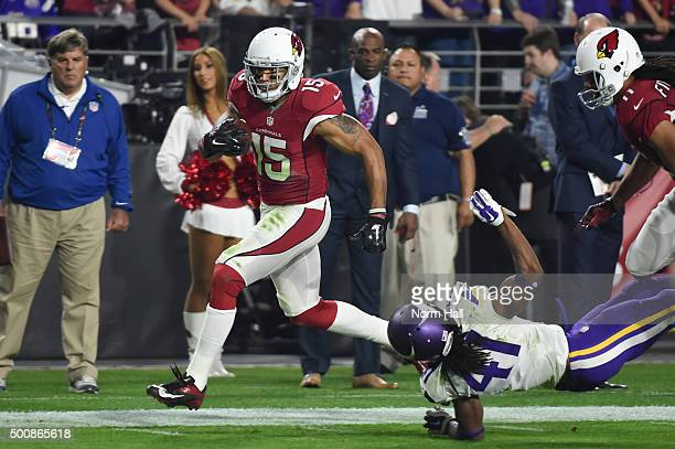 Wide receiver Michael Floyd of the Arizona Cardinals runs in a 42 yard touchdown reception in front of safety Anthony Harris of the Minnesota Vikings...