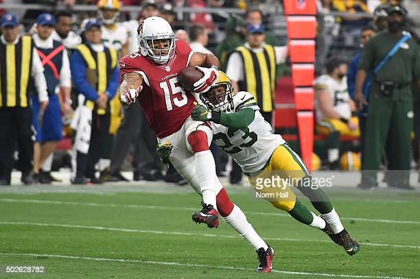 Wide receiver Michael Floyd of the Arizona Cardinals runs with the football against cornerback Damarious Randall of the Green Bay Packers in the...