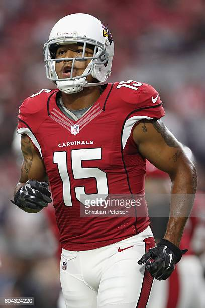 Wide receiver Michael Floyd of the Arizona Cardinals warms up before the NFL game against the New England Patriots at the University of Phoenix...