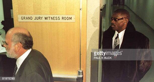 Wide receiver Michael Irvin of the Super Bowl champion Dallas Cowboys arrives 26 March to testify before a county grand jury about his presence at a...