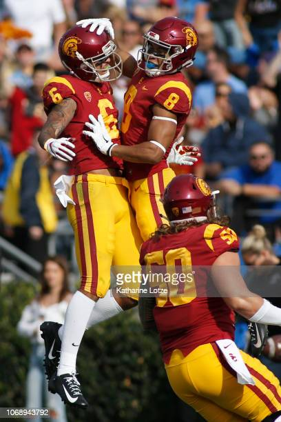 Wide receiver Michael Pittman Jr #6 of the USC Trojans and wide receiver AmonRa St Brown of the USC Trojans celebrate a touchdown during the first...